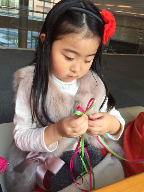 girl making lanyard
